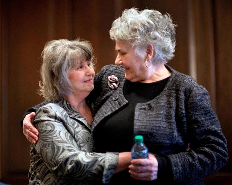 Susan Harrison, 63, of Lawrenceville, Ga., left, and Vea Gaby, 73, of Athens, embrace after telling their stories about complications from having surgical mesh placed in their pelvic cavities following an interview in their attorney's office, Monday, Jan. 28, 2013, in Athens, Ga. The Georgia women are some of the thousands of women nationwide who have sued manufacturers of the surgical mesh, claiming they've suffered severe complications and intense physical pain when the flexible plastic mesh hardened inside their bodies. (AP Photo/David Goldman)