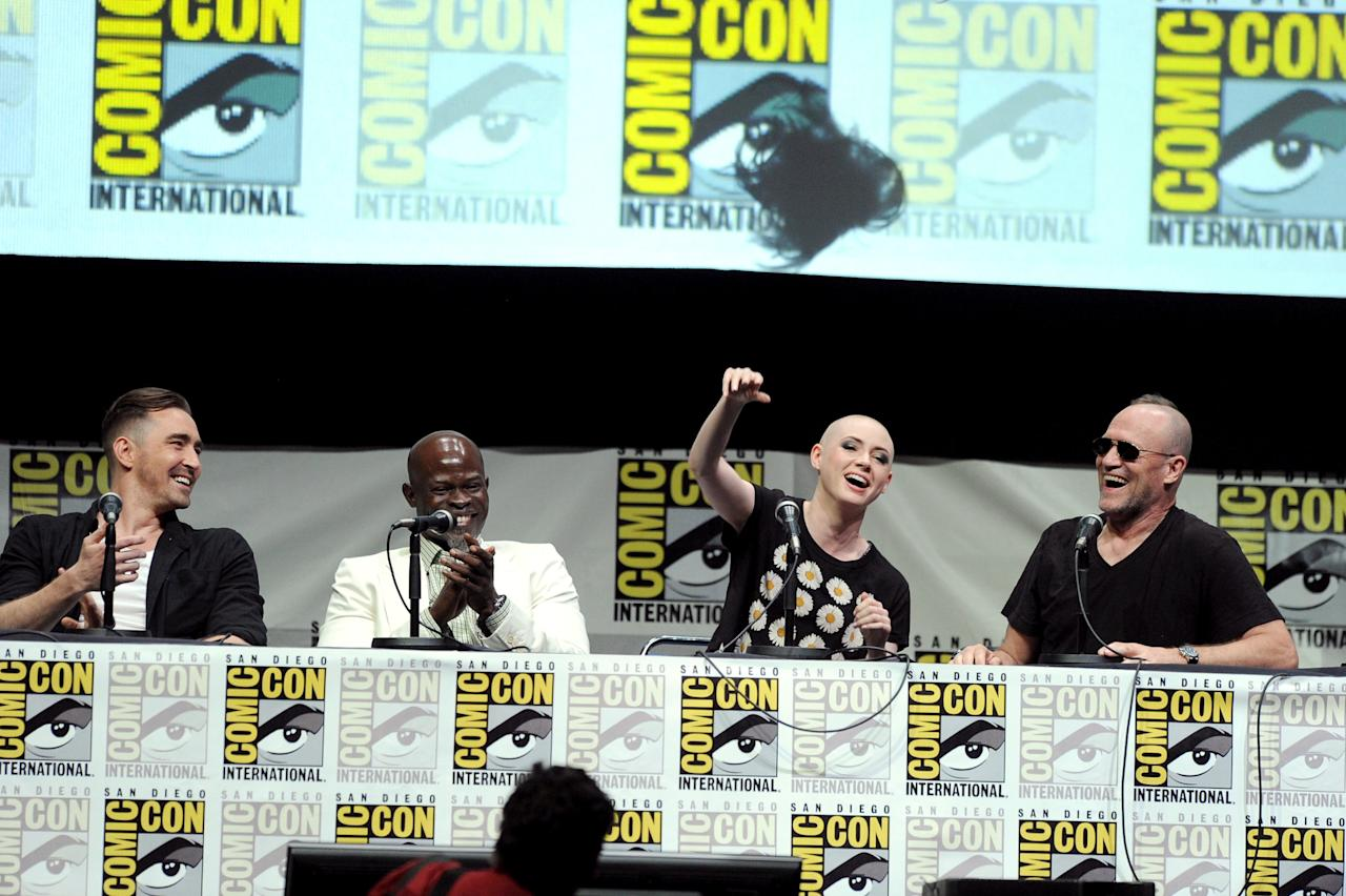 "SAN DIEGO, CA - JULY 20: (L-R) Actors Lee Pace, Djimon Hounsou, Karen Gillan and Michael Rooker speak onstage at Marvel Studios ""Guardians of the Galaxy"" during Comic-Con International 2013 at San Diego Convention Center on July 20, 2013 in San Diego, California. (Photo by Kevin Winter/Getty Images)"