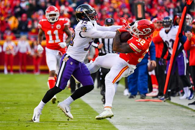 <p>Eric Weddle #32 of the Baltimore Ravens knocks Spencer Ware #32 of the Kansas City Chiefs out of bounds during the second quarter of the game at Arrowhead Stadium on December 9, 2018 in Kansas City, Missouri. (Photo by Peter Aiken/Getty Images) </p>