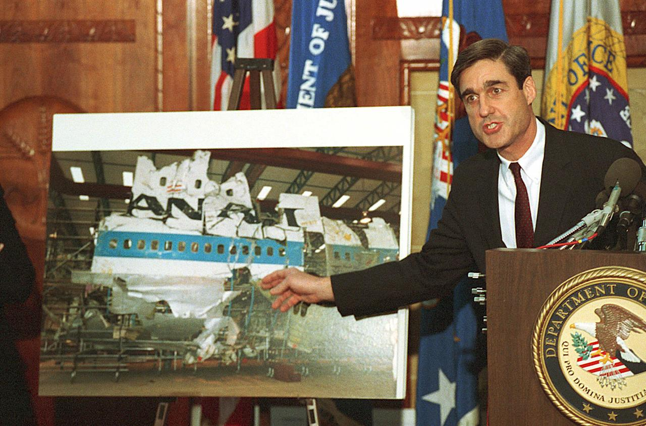 <p>Assistant Attorney General Robert Mueller III points Nov.14,1991 to a photo of the reconstructed wreckage of Pan Am Flight 103, which exploded over Lockerbie Scotland in 1988, killing 270 people. (Photo: Barry Thumma/AP) </p>