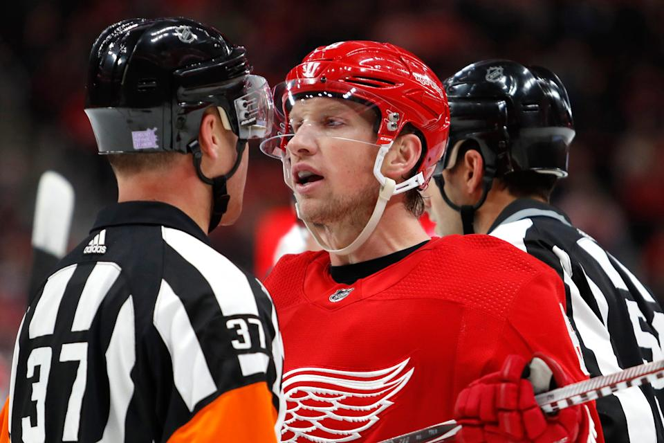 Detroit Red Wings left wing Justin Abdelkader talks with referee Kyle Rehman during the second period against the Edmonton Oilers at Little Caesars Arena, Nov. 3, 2018.