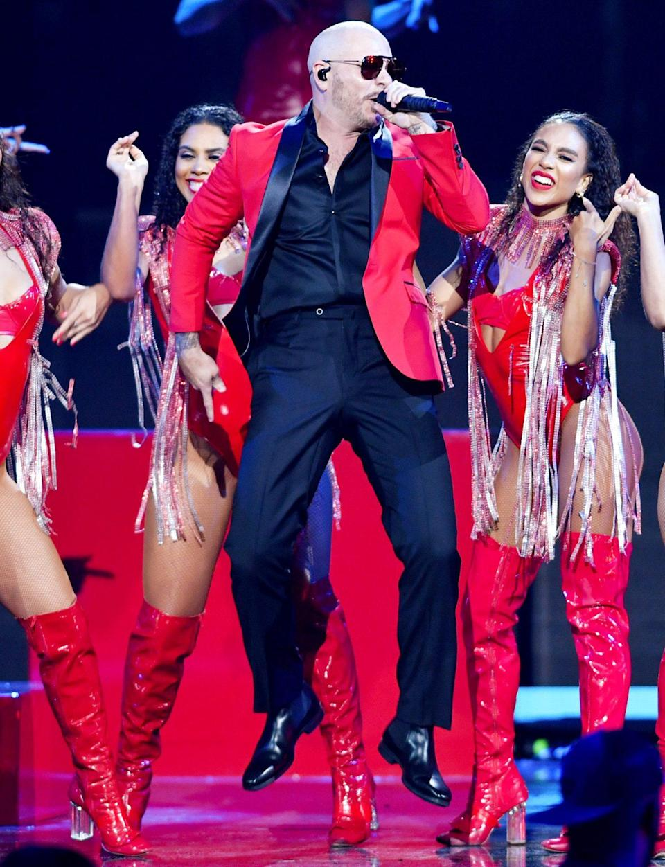 <p>Pitbull lights up the stage at Premios Juventud 2021 at Watsco Center on July 22 in Coral Gables, Florida.</p>