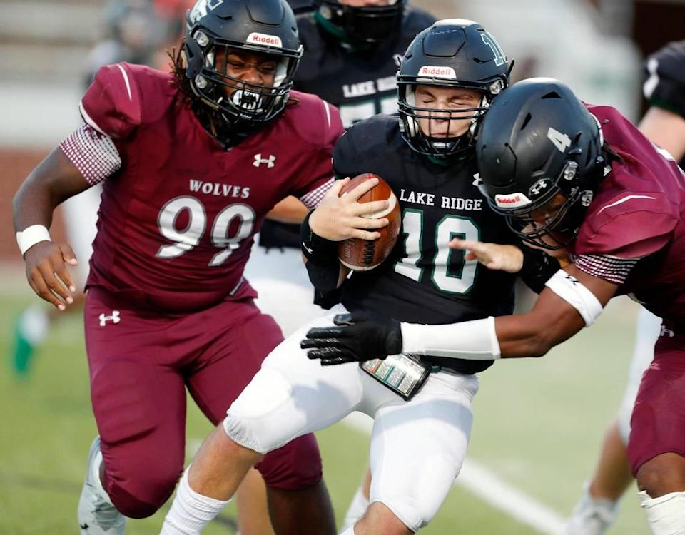 Timberview's defense consisting of (99) and defensive end Terrell Tilmon (4) bring down Lake Ridge quarterback Trevor Andrews (10) in the backfield during a high school football game at Vernon Newsom Stadium in Mansfield, Texas, Thursday, Sept. 24, 2020. Timberview defeated Lake Ridge 28-14 in their first game of the season. (Special to the Star-Telegram Bob Booth)