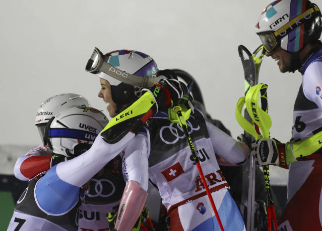 The Swiss team celebrates winning the gold medal in the finish area during the team event, at the alpine ski World Championships in Are, Sweden, Tuesday, Feb. 12, 2019. (AP Photo/Alessandro Trovati)
