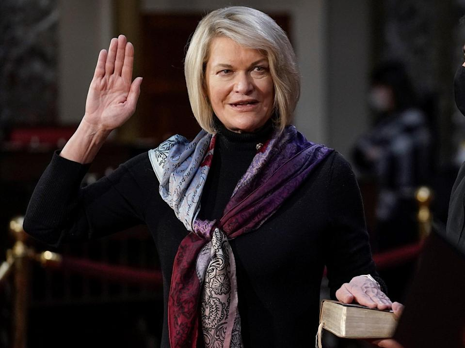 Senator Cynthia Lummis takes the oath of office during a mock swearing-in ceremony in the Old Senate Chamber at the Capitol on 3 January, 2021 in Washington, DC (Getty Images)