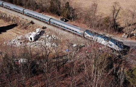 The wreckage of a garbage truck lies beside an Amtrak passenger train after a collision in Crozet