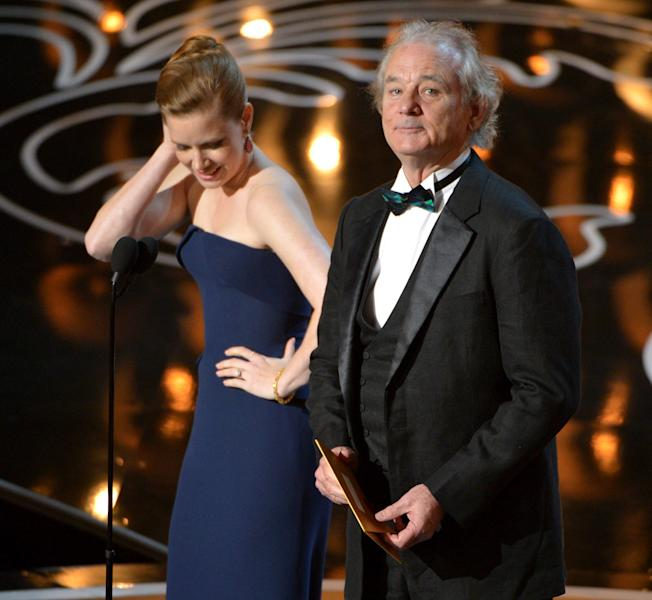 Amy Adams, left, and Bill Murray speak on stage during the Oscars at the Dolby Theatre on Sunday, March 2, 2014, in Los Angeles. (Photo by John Shearer/Invision/AP)
