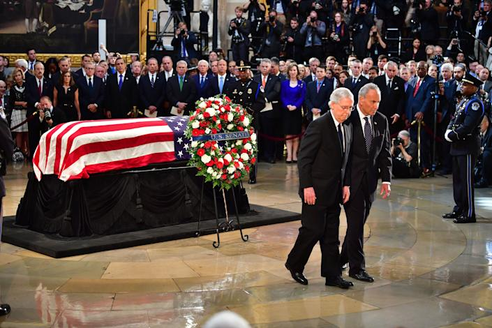 Sens. Chuck Schumer (right) and Mitch McConnell (left) walk away after viewing the casket.