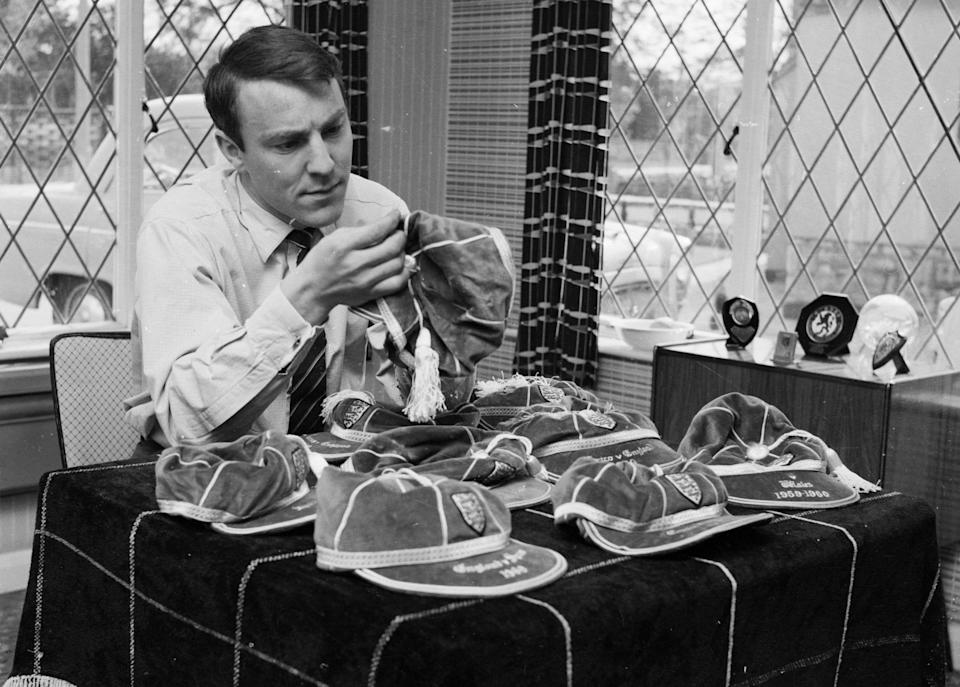 Former England, Tottenham and Chelsea striker, Jimmy Greaves dies aged 81 20th April 1961: Jimmy Greaves, Chelsea's inside left inspects his nine England caps - John Franks/Keystone Features/Getty Images