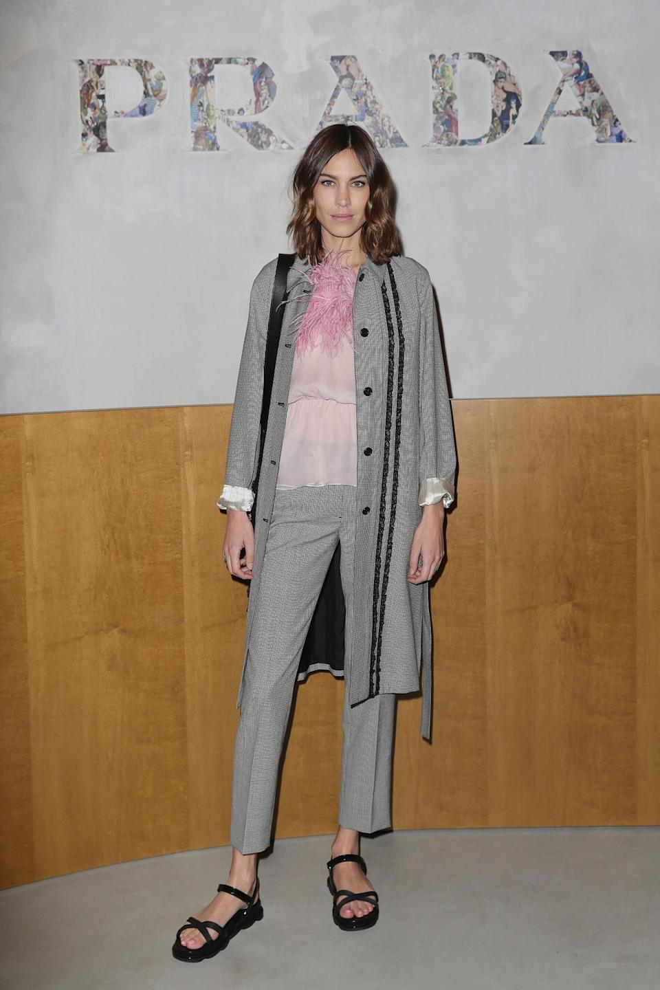 <p>Alexa Chung mixed Prada's 'ugly' sandals with a subtle houndstooth suit. <i>[Photo: Getty]</i> </p>