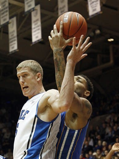 Duke's Mason Plumlee, left, and Delaware's Jamelle Hagins reach for a rebound during the first half of an NCAA college basketball game in Durham, N.C., Saturday, Dec. 1, 2012. (AP Photo/Gerry Broome)