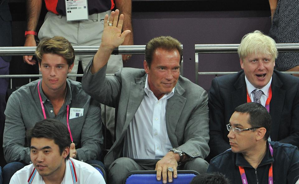 LONDON, ENGLAND - AUGUST 12: (L-R) Patrick Schwarzenegger, Arnold Schwarzenegger and London Mayor Boris Johnson during the Men's Basketball gold medal game between the United States and Spain on Day 16 of the London 2012 Olympics Games at North Greenwich Arena on August 12, 2012 in London, England. (Photo by Pascal Le Segretain/Getty Images)
