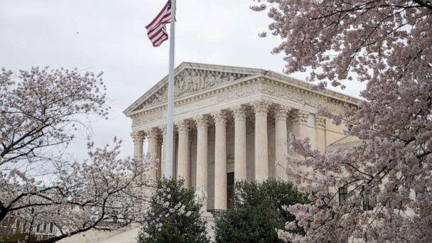PHOTO: The flag flies above the Supreme Court building in Washington, D.C., March 31, 2021. (Shawn Thew/EPA via Shutterstock)
