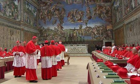 Cardinals enter the Sistine Chapel, in a still image taken from video at the Vatican March 12, 2013. REUTERS/Vatican CTV via Reuters Tv/Files