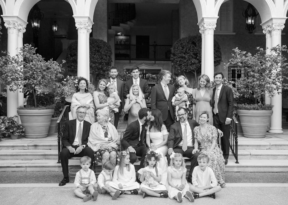 """This may be my favorite photo from the night—our entire wedding party! Our photographer <a href=""""https://www.instagram.com/johndolanphotog/?hl=en"""" rel=""""nofollow noopener"""" target=""""_blank"""" data-ylk=""""slk:John Dolan"""" class=""""link rapid-noclick-resp"""">John Dolan</a> had the idea to take a traditional Italian family style portrait."""