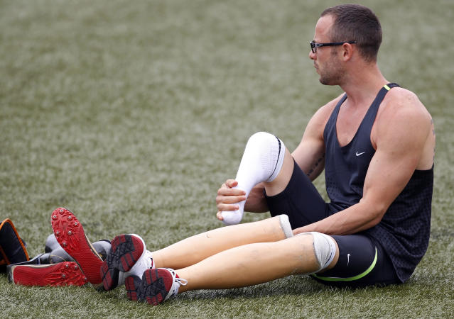 Oscar Pistorius of South Africa removes his prosthetic legs before wearing his running blades during a training session for the IAAF Daegu 2011 World Championship in Daegu August 24, 2011. REUTERS/Max Rossi (SOUTH KOREA - Tags: SPORT ATHLETICS) - RTR2Q93M