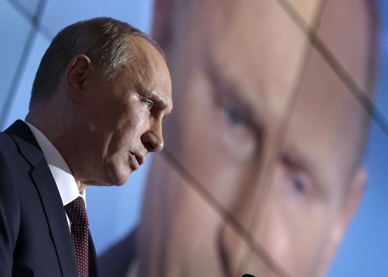 Russian President Vladimir Putin gestures as he speaks during the final plenary meeting of the Valdai International Discussion Club in the Novgorod Region, on the banks of Lake Valdai, Russia, Thursday, Sept. 19, 2013. (AP Photo/Maxim Shipenkov, pool)