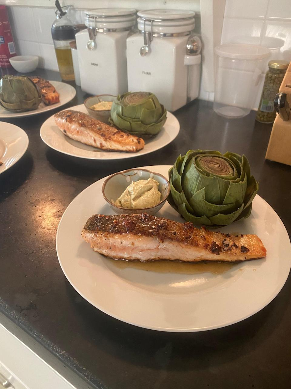 """Instead of an artichoke, Margulies typically pairs her crispy garlic salmon with French green beans (""""They are thinner than the standard green bean, and more delicate,"""" she says), as well as what she calls Mama Rice—brown rice with slivered almonds and cooked chopped onions."""