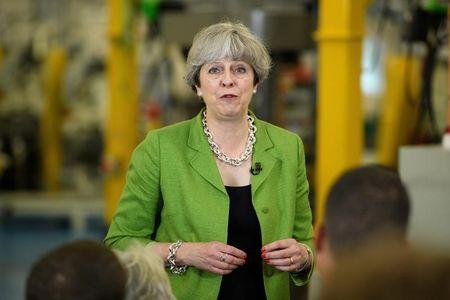May's lead down to 5 pct as her campaign struggles