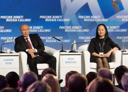 "Russia's President Vladimir Putin (L) and Meng Wanzhou, Executive Board Director of the Chinese technology giant Huawei, attend a session of the VTB Capital Investment Forum ""Russia Calling!"" in Moscow, Russia October 2, 2014. REUTERS/Alexander Bibik"