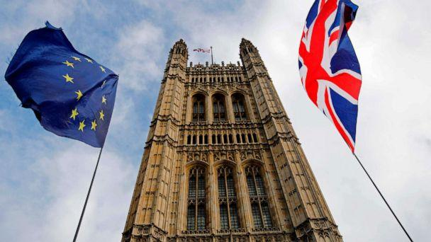 PHOTO: EU and Union flags flutter in the breeze in front of the Victoria Tower, part of the Palace of Westminster in central London, Oct. 17, 2019. (Tolga Akmen/AFP via Getty Images)