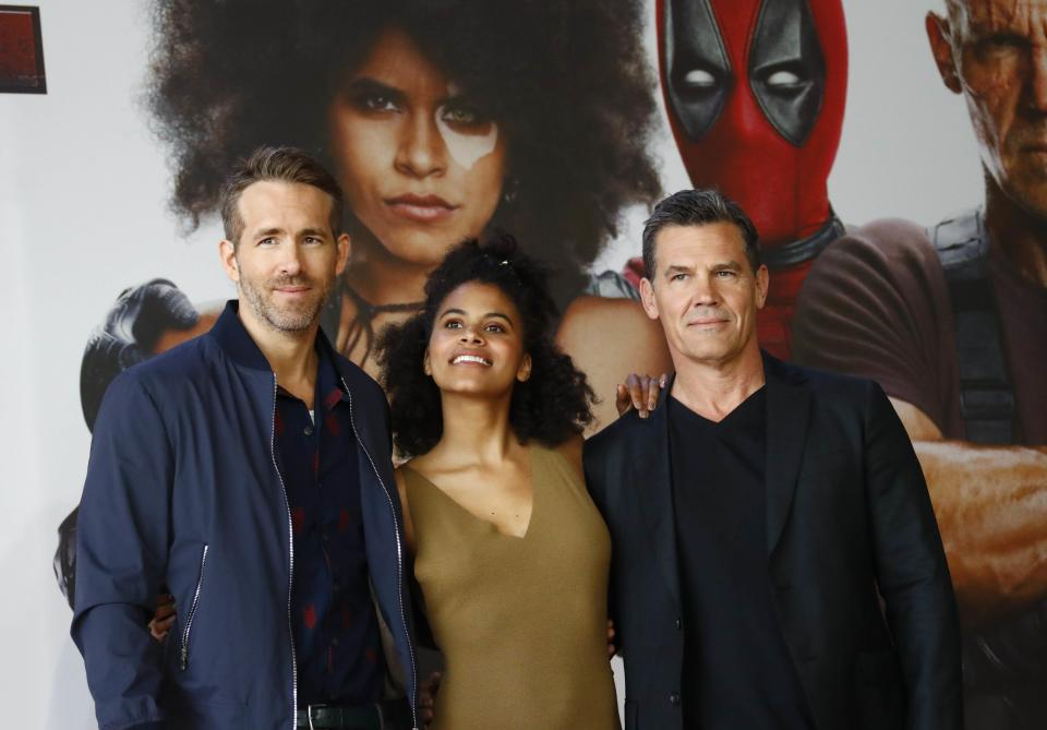 "(L-R) Cast members Ryan Reynolds, Zazie Beetz and Josh Brolin pose for a picture during a photo call for the movie ""Deadpool 2"" ahead of the premiere in Berlin, Germany May 11, 2018. REUTERS/Fabrizio Bensch"