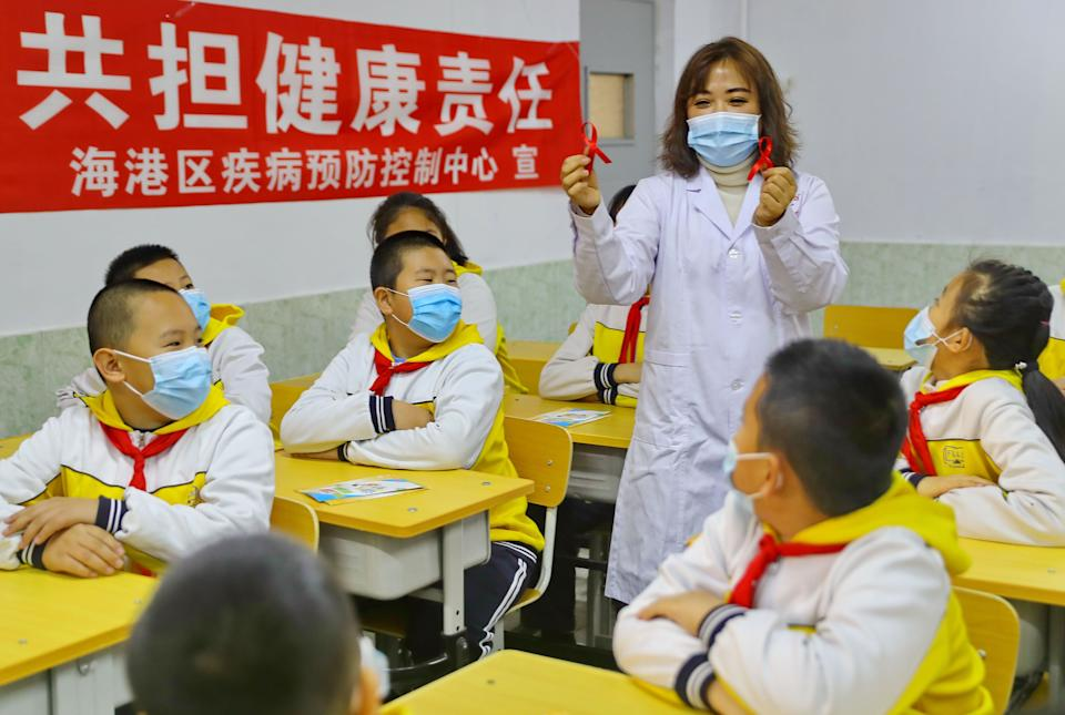 QINHUANGDAO, CHINA - NOVEMBER 30: Students learn knowledge about AIDS from a staff member of a disease control and prevention center before the World AIDS Day on November 30, 2020 in Qinhuangdao, Hebei Province of China. The 33rd World AIDS Day falls on Tuesday this year. (Photo by Cao Jianxiong/VCG via Getty Images) (Photo: VCG via Getty Images)