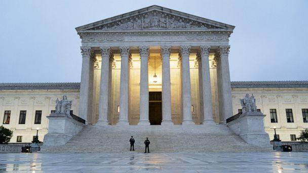 PHOTO: Police officers stand outside the U.S. Supreme Court building in Washington, Oct. 26, 2020. (Bloomberg via Getty Images)