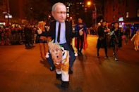 <p>A man dressed as Russian President Vladimir Putin gives a thumbs-up to specators while marching in the 44th annual Village Halloween Parade in New York City on Oct. 31, 2017. (Photo: Gordon Donovan/Yahoo News) </p>