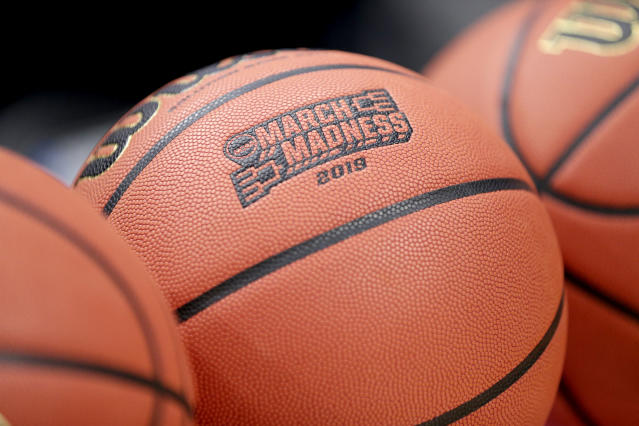"""FILE - This Wednesday, March 20, 2019, file photo shows a basketball with March Madness 2019 in a rack before Michigan practice at the NCAA college basketball tournament in Des Moines, Iowa. An Ohio man has made history with a March Madness bracket that's perfect through 48 games on the NCAA.com's """"Bracket Challenge,"""" according to the NCAA. (AP Photo/Nati Harnik, File)"""