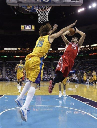 Houston Rockets small forward Chandler Parsons (25) shoots against New Orleans Hornets center Robin Lopez (15) in the first half of an NBA basketball game in New Orleans, Friday, Jan. 25, 2013. (AP Photo/Gerald Herbert)