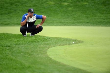 May 19, 2019; Bethpage, NY, USA; Brooks Koepka lines up his shot on the 14th green during the final round of the PGA Championship golf tournament at Bethpage State Park - Black Course. Mandatory Credit: John David Mercer-USA TODAY Sports