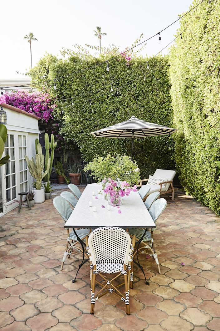 """""""The TV room kind of spills out into that bougainvillea wall. So it is kind of cool how you start the pink palette in the TV room and then all of a sudden you're outside with that pop of fuchsia. I love it,"""" says Spencer."""
