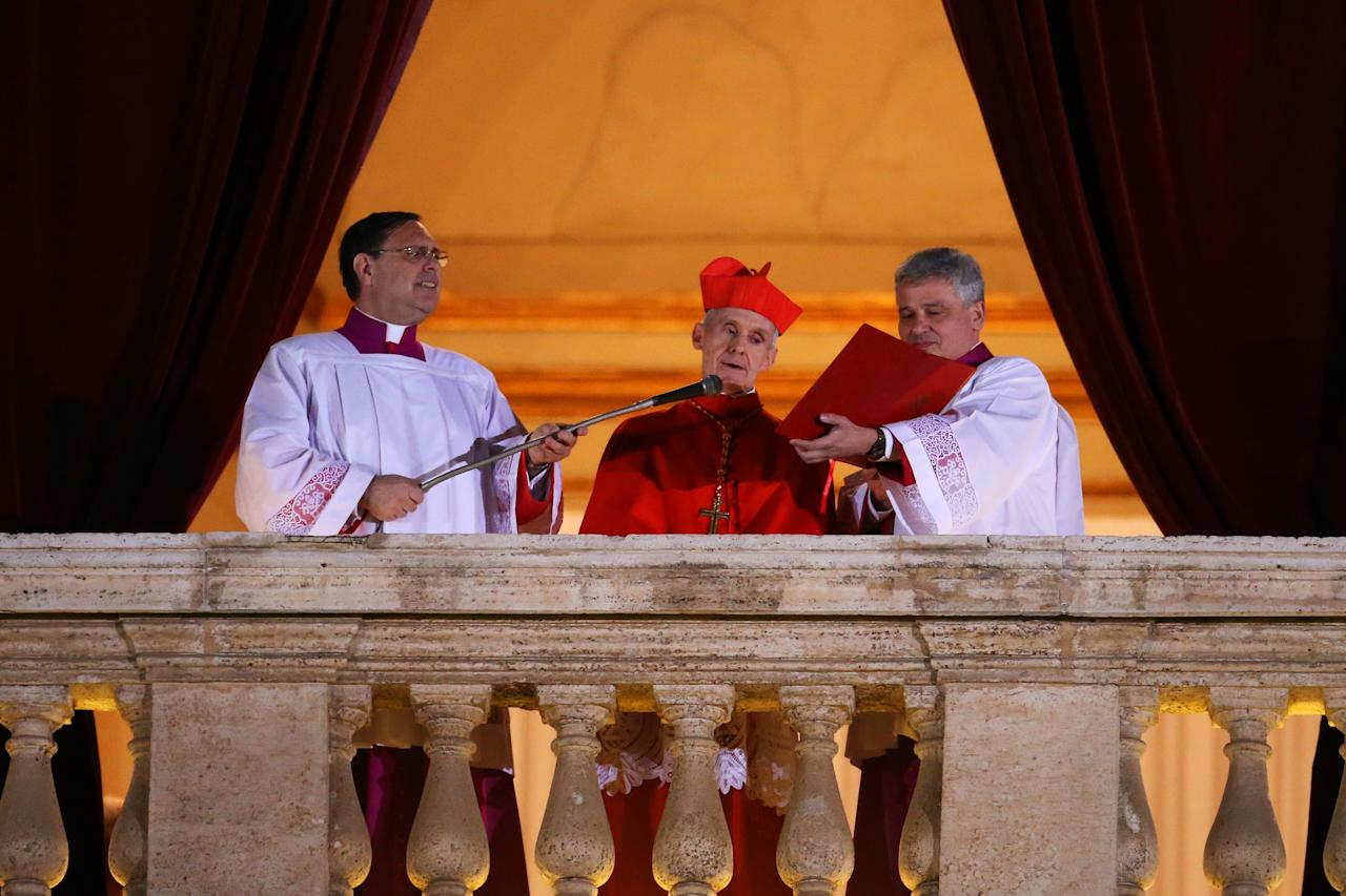 VATICAN CITY, VATICAN - MARCH 13:  French Cardinal Jean-Louis Tauran announces the newly elected Pope as Pope Francis I on the central balcony of St Peter's Basilica on March 13, 2013 in Vatican City, Vatican. Argentinian Cardinal Jorge Mario Bergoglio was elected as the 266th Pontiff and will lead the world's 1.2 billion Catholics.  (Photo by Peter Macdiarmid/Getty Images)