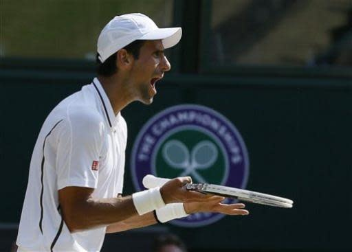 Novak Djokovic of Serbia reacts during the Men's singles final match against Andy Murray of Britain at the All England Lawn Tennis Championships in Wimbledon, London, Sunday, July 7, 2013. (AP Photo/Kirsty Wigglesworth)