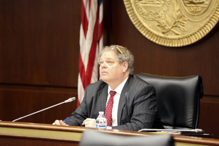 State Rep. Weston Newton, R-Bluffton, watches a screen where testimony is heard via streaming during the House subcommittee hearing he chairs on an abortion bill on Wednesday, Feb. 3, 2021, in Columbia, S.C. The bill would outlaw almost all abortions in the state. (AP Photo/Jeffrey Collins)