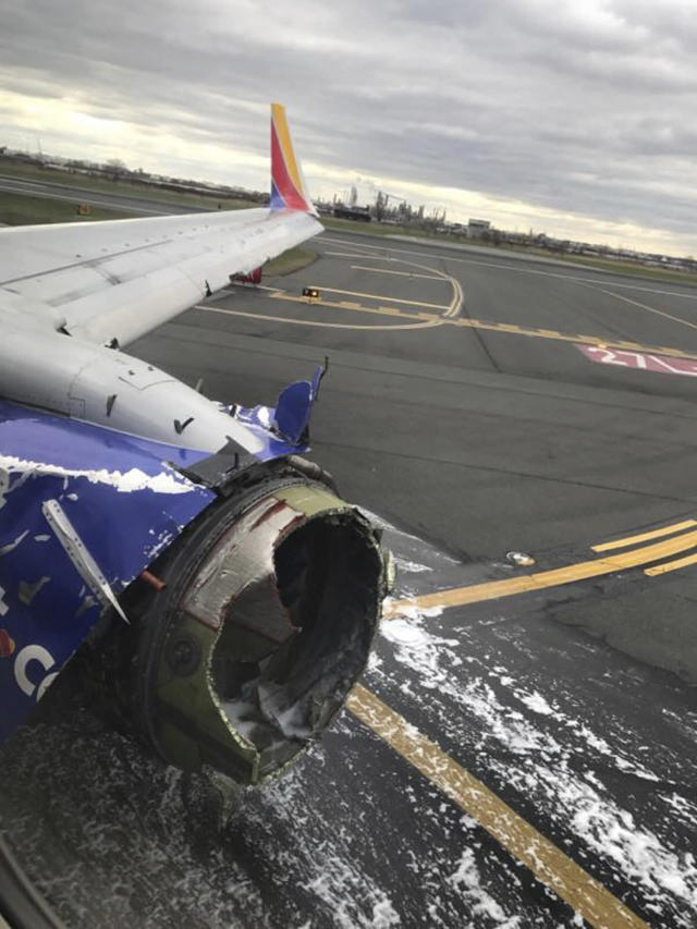 <p>This April 17, 2018 photo provided by Marty Martinez shows the jet engine casing of a Southwest Airlines airplane Martinez was a passenger on after pilots of the twin-engine Boeing 737 bound from New York to Dallas with 149 people aboard took it into a rapid descent and made an emergency landing in Philadelphia. (Photo: Marty Martinez via AP) </p>