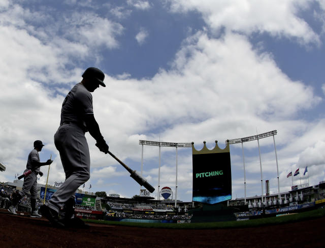 New York Yankees' Luke Voit, second from left, and Aaron Hicks warm up before batting in the first inning of the first baseball game in a double header against the Kansas City Royals, Saturday, May 25, 2019, in Kansas City, Mo. (AP Photo/Charlie Riedel)