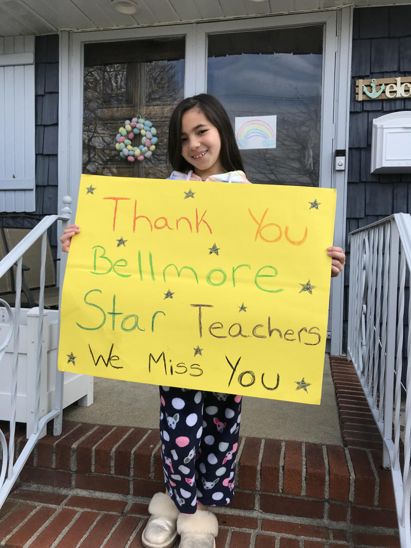 Carla Wong of Bellmore, New York, said her daughter Brooke, 8, misses her friends and teachers now that they are at home in isolation due to the COVID-19 pandemic. She was so excited about seeing her teachers even from a distance that she waited outside i (Courtesy of Carla Wong)