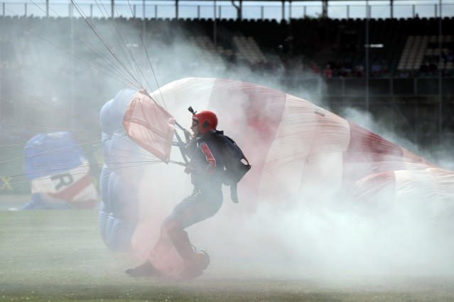Royal Air Force parachutists land in front of the stands after the second free practice at the Silverstone racetrack, in Silverstone, England, Friday, July 12, 2019. The British Formula One Grand Prix will be held on Sunday. (AP Photo/Luca Bruno)