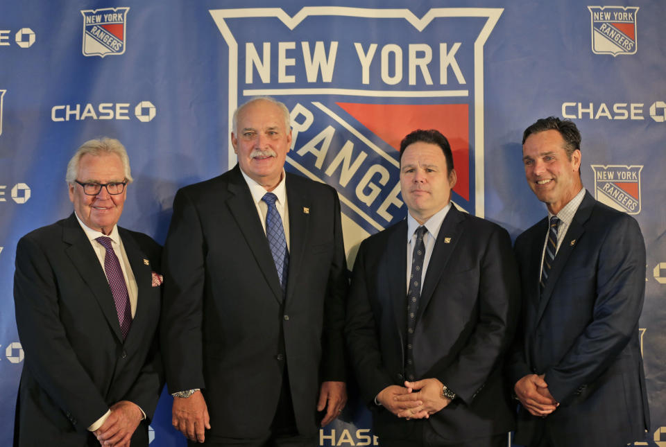 John Davidson, the new president of the New York Rangers, second from left, poses for a picture with adviser to the owner, Glen Sather, left, general manager Jeff Gorton, second from right, and coach David Quinn during a news conference in New York, Wednesday, May 22, 2019. Davidson was hired as team president Friday hours after leaving his post with the Columbus Blue Jackets. He returns to New York where he spent parts of eight seasons as a Rangers goaltender and was a TV analyst for almost a decade. (AP Photo/Seth Wenig)