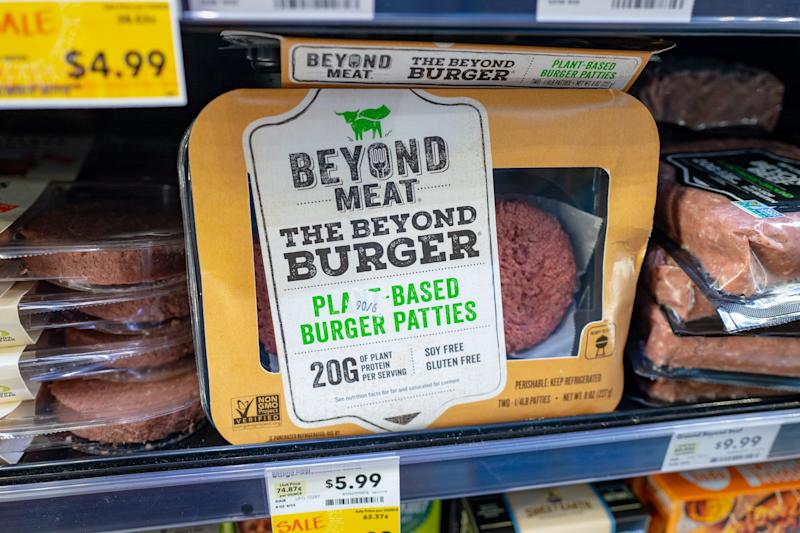 Engineered plant-based burger patties from food company Beyond Meat are visible on shelves among other meat alternatives at a grocery store in San Ramon, California, August 28, 2019. (Photo by Smith Collection/Gado/Getty Images)