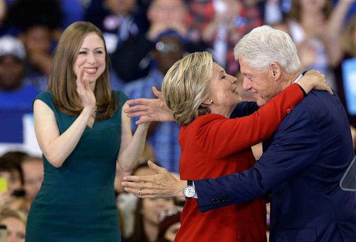 <p>Democratic presidential candidate Hillary Clinton hugs her husband, former President Bill Clinton as their daughter Chelsea Clinton looks on during a campaign rally in Raleigh, N.C., Tuesday, Nov. 8, 2016. (Photo: Gerry Broome/AP) </p>