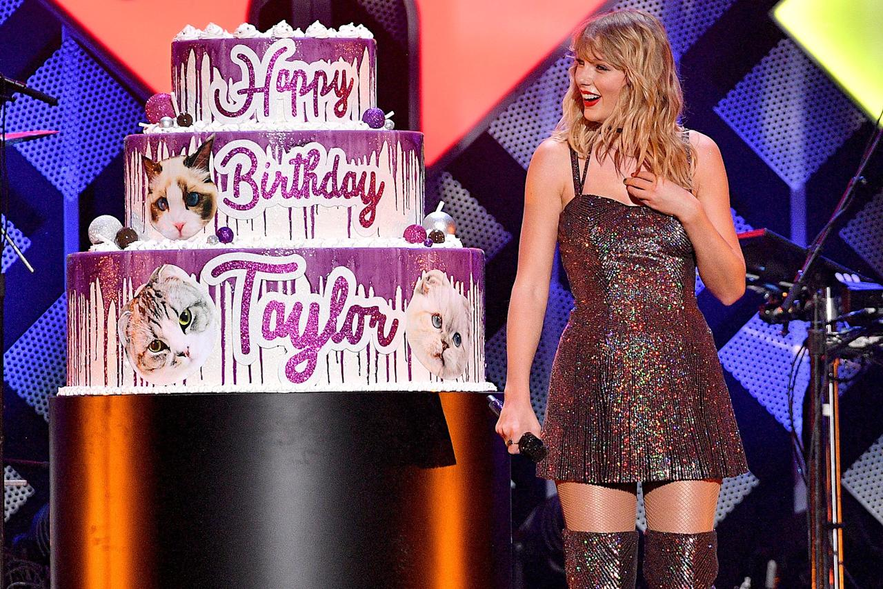 Taylor Swift is surprised with a giant birthday cake onstage during iHeartRadio's Z100 Jingle Ball 2019 presented by Capital One in New York City on Friday night.