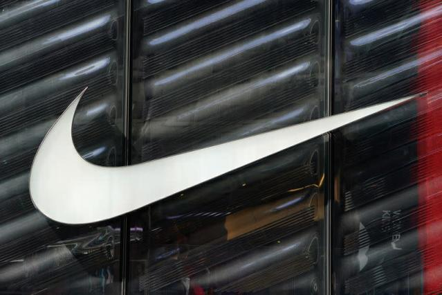 The Nike swoosh logo is seen outside the store on 5th Ave in New York