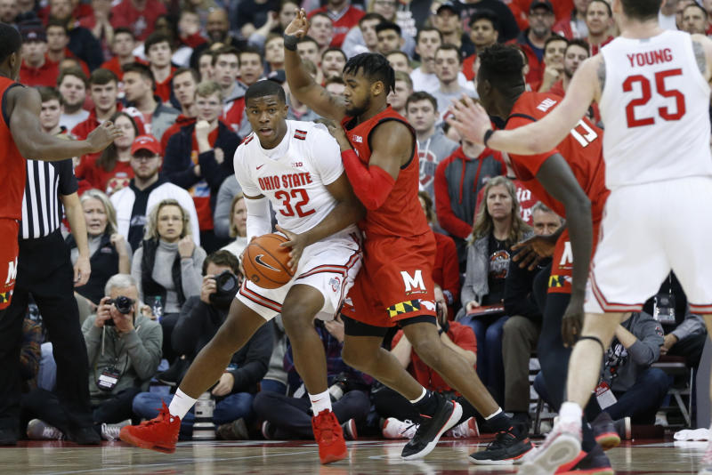 Ohio State's E.J. Liddell, left, looks for an open pass as Maryland's Donta Scott defends during the first half of an NCAA college basketball game Sunday, Feb. 23, 2020, in Columbus, Ohio. (AP Photo/Jay LaPrete)