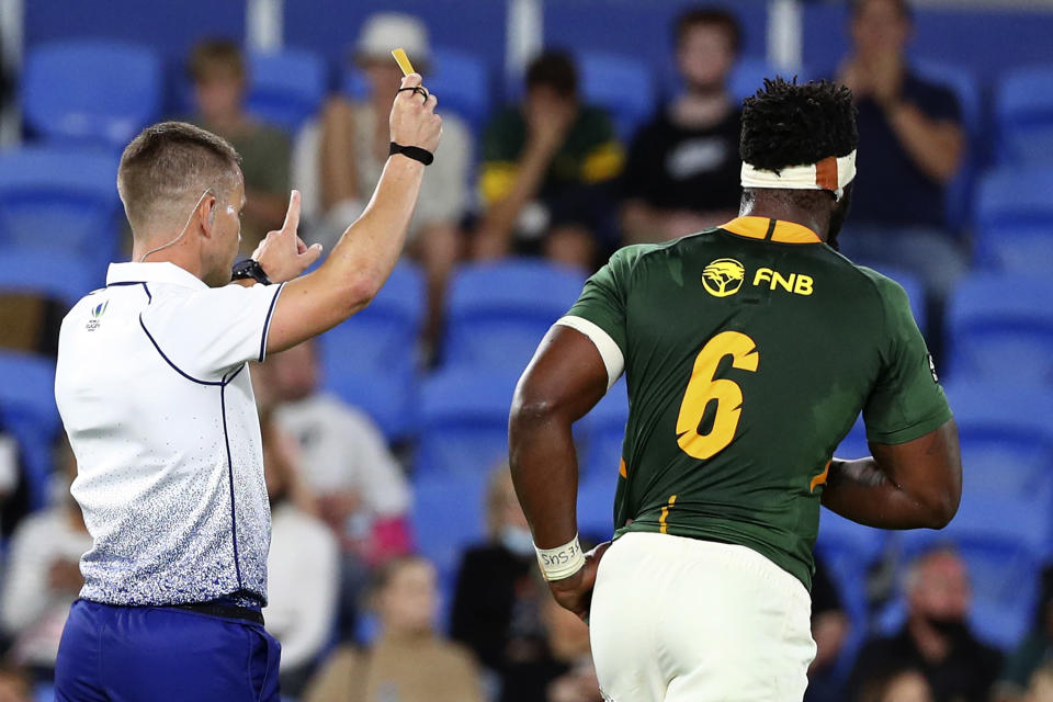 South Africa's Siya Kolisi, right, is sent off by Luke Pearce during their Rugby Championship match against Australia on Sunday, Sept. 12, 2021, Gold Coast, Australia. (AP Photo/Tertius Pickard)