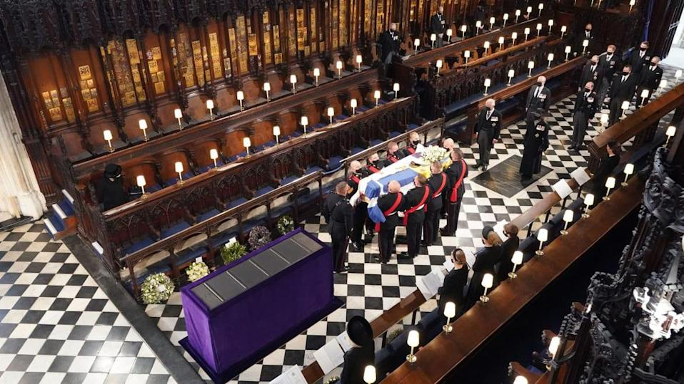 "<div class=""inline-image__caption""><p>Queen Elizabeth II (L) watches as pallbearers carry the coffin of Britain's Prince Philip, Duke of Edinburgh during his funeral inside St George's Chapel in Windsor Castle in Windsor, west of London, on April 17, 2021.</p></div> <div class=""inline-image__credit"">Dominic Lipinski / POOL / Getty</div>"