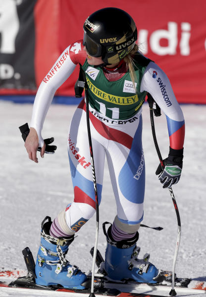 Switzerland's Lara Gut looks back at the video screen to watch a replay of her run during the women's World Cup downhill skiing event, Friday, Nov. 29, 2013, in Beaver Creek, Colo. (AP Photo/Julie Jacobson)