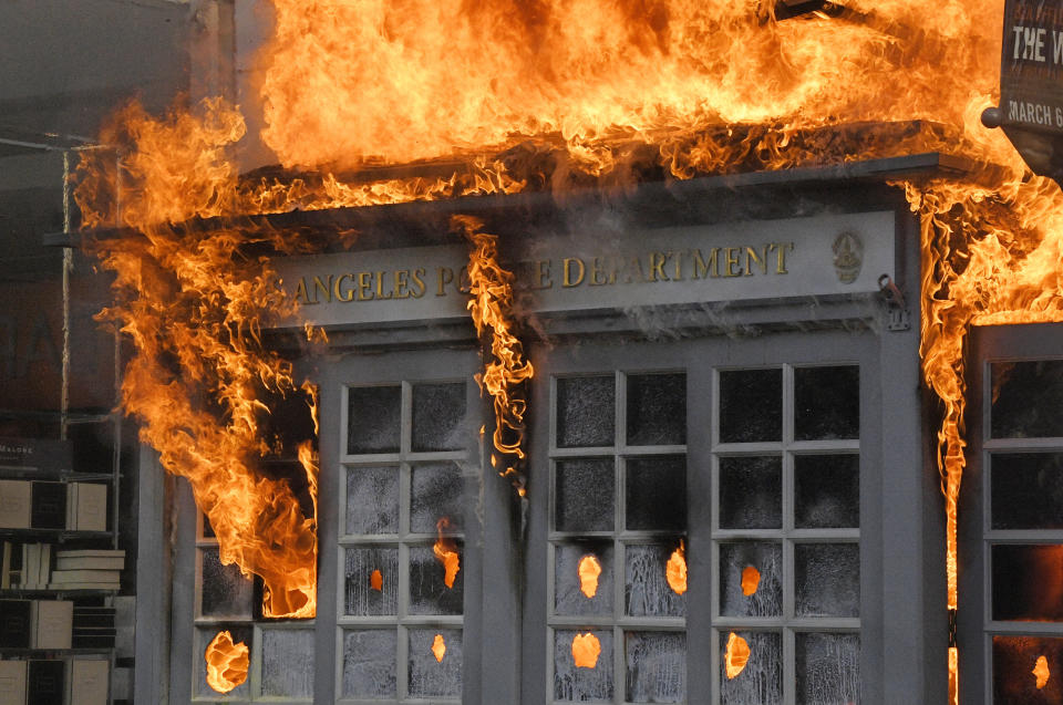 Pictured is a Los Angeles Police Department kiosk on fire in The Grove shopping center during a protest over the death of George Floyd.